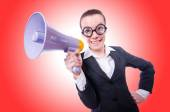 Young businesswoman with loudspeaker — Stock Photo