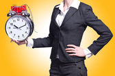 Woman with dynamite and clock — Stock Photo