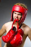 Funny boxer with red gloves — Stock Photo
