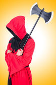 Executioner in red costume with axe — Stock Photo