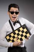 Funny chess player with board — Foto Stock