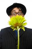 Young man in black costume with flower isolated on white — Stock Photo