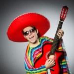 Man in red sombrero playing guitar — Foto de Stock   #72085897
