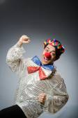 Funny clown against dark background — Stock Photo