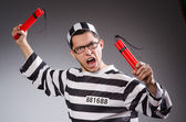 Funny prisoner with dynamite — Stock Photo