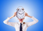 Woman businesswoman with giant clock — Stock Photo