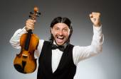 Man playing violin in musical concept — Stock Photo