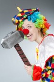 Clown with hammer in funny concept — Stock Photo