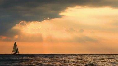 Sunset at sea. Sailboat — Stock Video