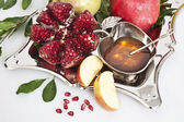 Honey with apple and garnet — Stock Photo