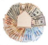 Доллар, евро и модель дома — Стоковое фото