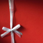 Fancy white ribbon gift bow — Stock Photo