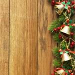 Decorated Christmas tree border on wood paneling — Stock Photo #55539031