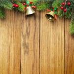 Decorated Christmas tree border on wood paneling — Stock Photo #57528879