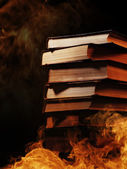 Stack of books in a burning fire — Stock Photo