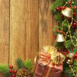 Decorated Christmas tree border on wood paneling — Stock Photo #58814997