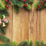 Decorated Christmas tree border on wood paneling — Stock Photo #59322525