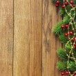 Decorated Christmas tree border on wood paneling — Stock Photo #60327629
