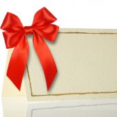 Blank gift tag tied with a bow of red satin ribbon. — Stock Photo
