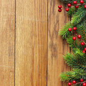 Decorated Christmas tree border on wood paneling — Stok fotoğraf