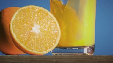 Pouring orange juice in glass — Stock Video