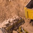 Excavator loading crushed rock — Stock Video #65947989