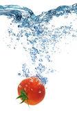 Tomato dropped into water — Stock Photo