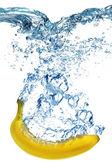 Banana dropped into water — Stock Photo