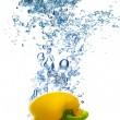 Yellow pepper dropped into water — Stock Photo #69957781