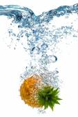Pineapple dropped into water — Stock Photo