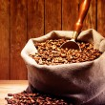 Coffee beans on burlap sack — Stock Photo #77406842