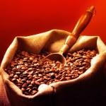 Coffee beans on burlap sack — Stock Photo #77438720