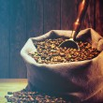 Coffee beans on burlap sack — Stock Photo #78056948