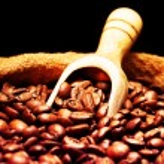 Coffee beans on burlap sack — Stock Photo #78057824