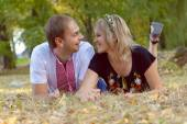 Portrait of a happy couple laughing at camera — Stock Photo