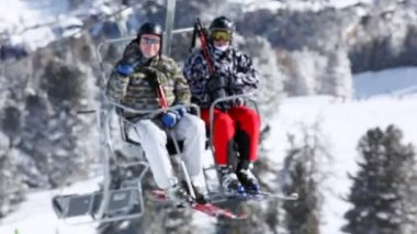 Two skiers rise in chairlift — Stock Video