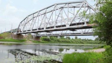 Freight train rides on bridge — Stock Video