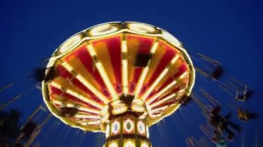 People fly on round spins carousel — Stock Video