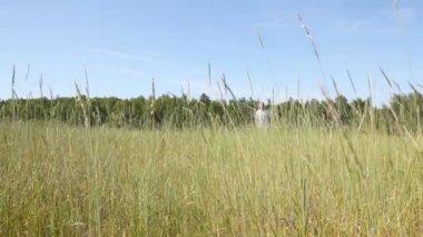 Guy runs across field — Stok video