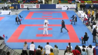 Two girls of karateka participate in duel — Stock Video