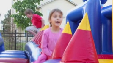 Little girl at inflatable playground — Stock Video
