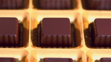 Chocolate candies in golden box — Stock Video