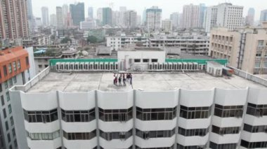 Group of young people on roof — Stok video
