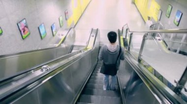 Man moves down on escalator — Stock Video