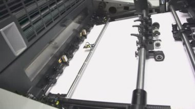 Wide white paper in printing conveyor — Stock Video