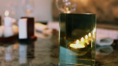 Hand rotates candle in candleholder — Stock Video