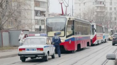 Policeman walk on street with tramways — Stock Video