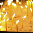 People in church put candles — Stock Video #60013701