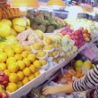 Young woman chooses fruits at market — Stock Video #60014957