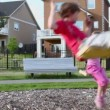 Boy and girl sway on swings — Stock Video #60015699
